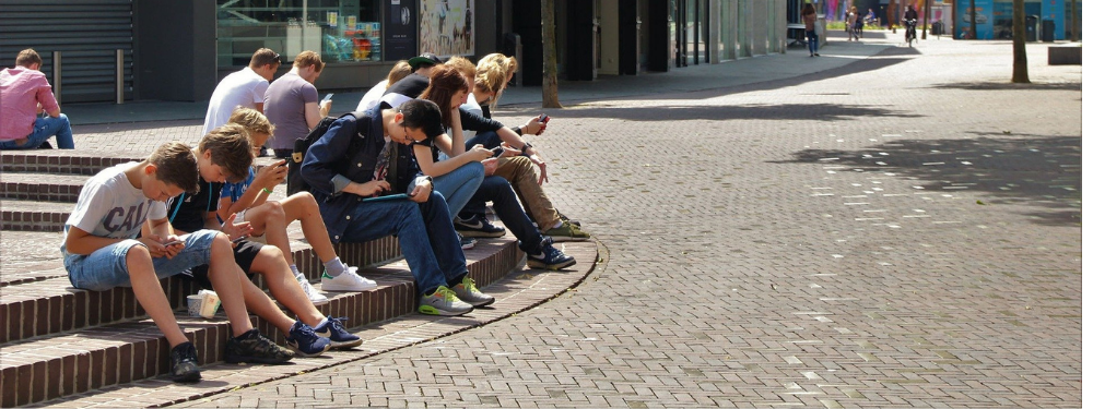 Young people using phones