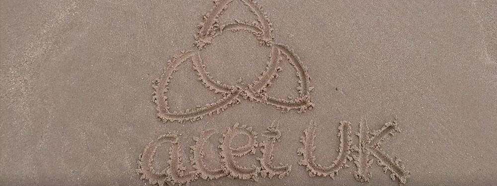 acet UK logo drawn in the sand at Spring Harvest Skegness