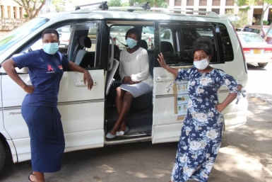 Team members with the project vehicle