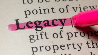 The word legacy being highlighted in a dictionary