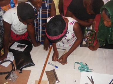 SGBV survivors being taught bag making