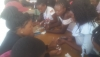 Adolescent peer educators being trained in beauty therapy