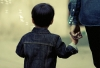 Parenthood resource: Child holding an adult's hand
