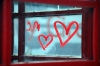 hearts drawn on phonebox window